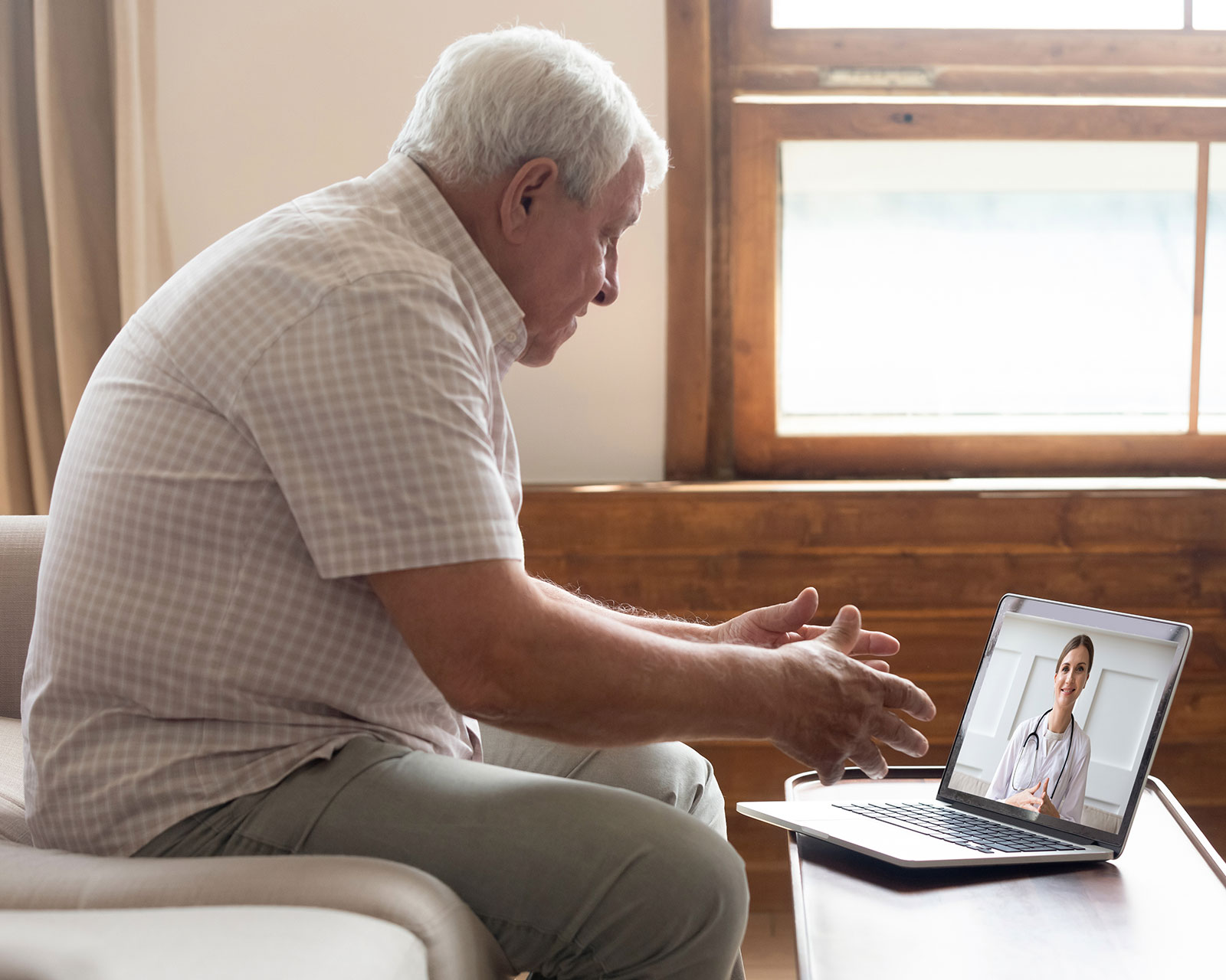 Man meeting with his doctor online about acromegaly